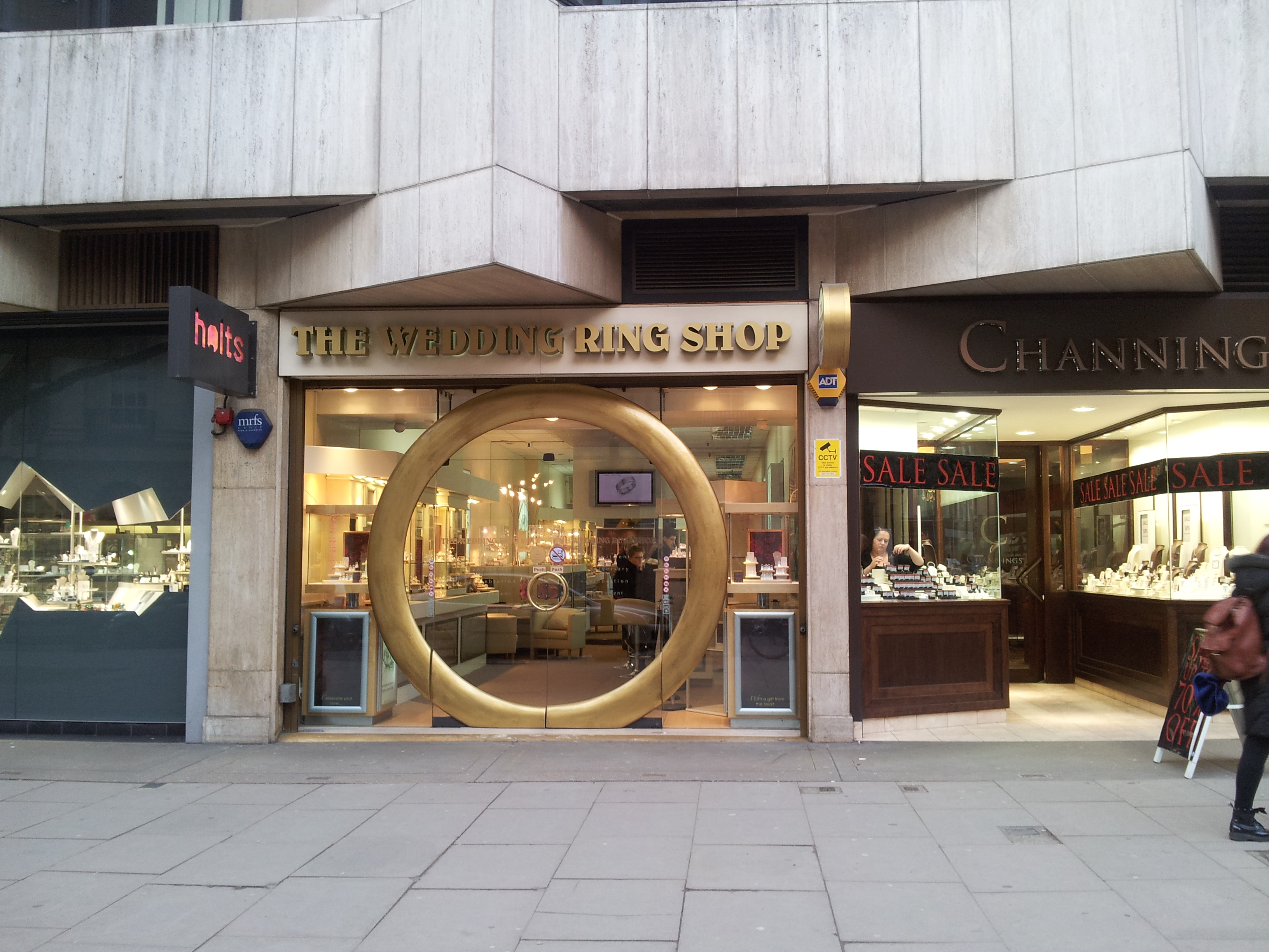 a shop called the wedding ring shop with a large gold painted ring set - The Wedding Ring Shop